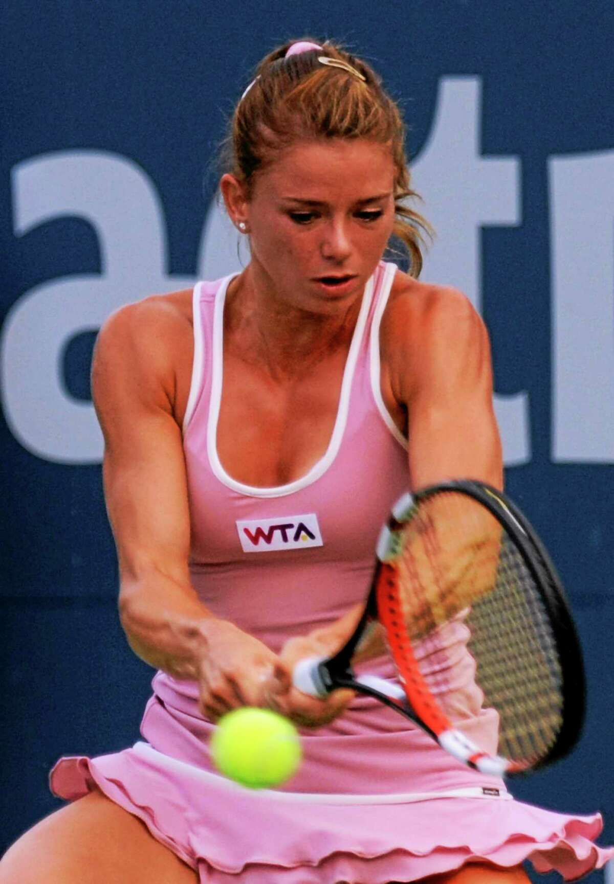Camila Giorgi returns a shot to Garbine Muguruza during her quarterfinal win on Thursday at the Connecticut Open.