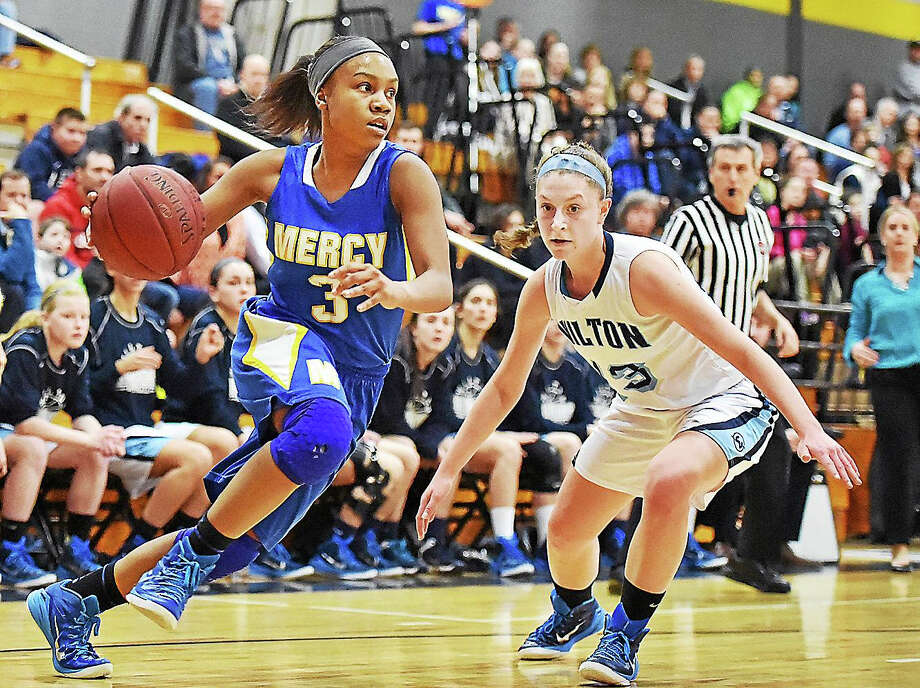 Mercy's Destine Perry makes her move against Wilton in last year's Class LL semifinals. The Tigers open their season at Hillhouse on Dec. 16. Photo: Catherine Avalone — Register  / New Haven RegisterThe Middletown Press