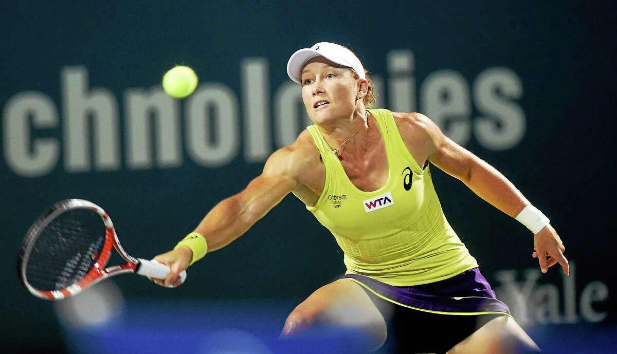 Sam Stosur returns a shot to Kirsten Flipkens during her 6-3, 4-6, 6-3 quarterfinal-round win on Thursday night at the Connecticut Open.