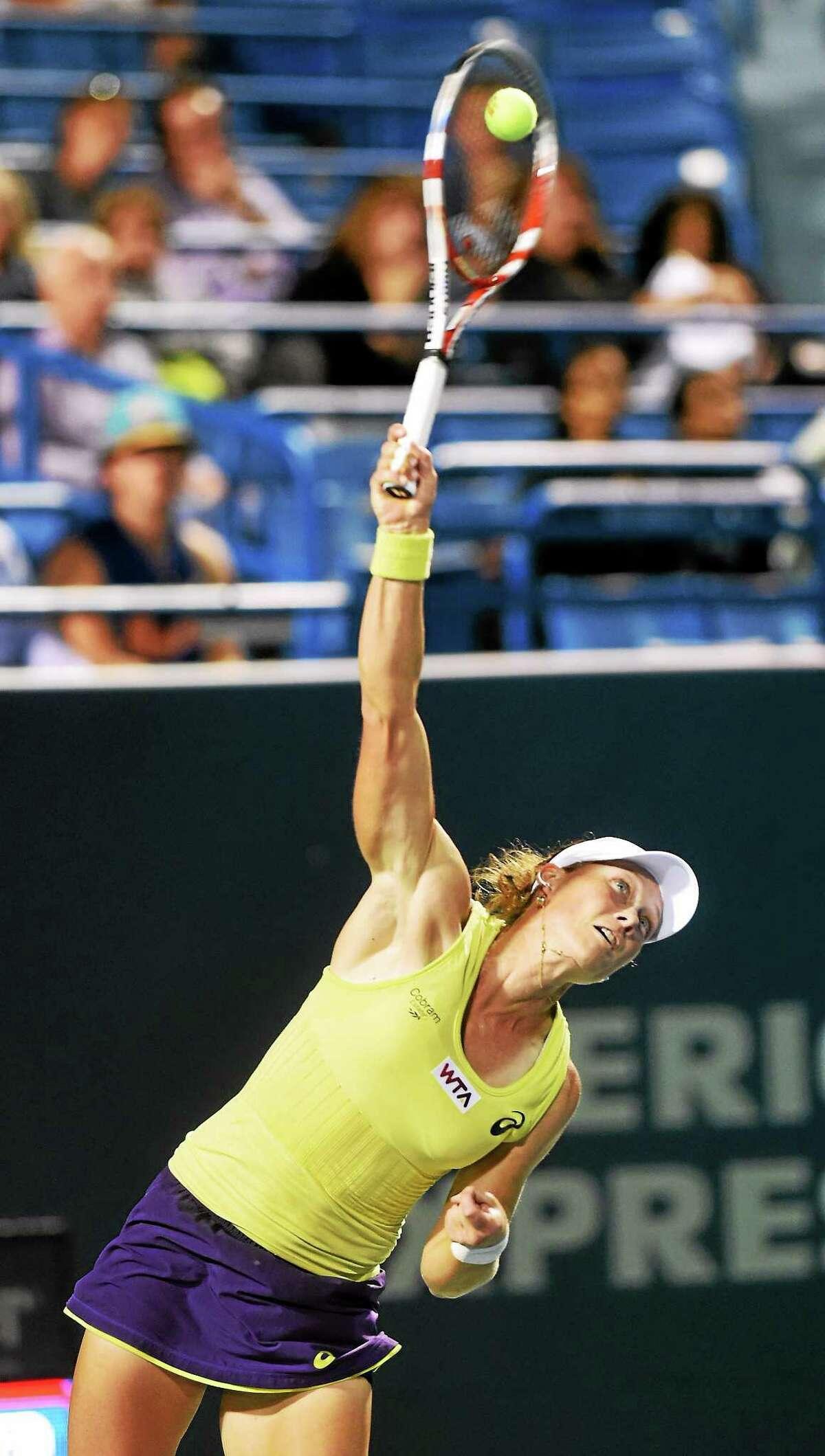 Sam Stosur serves to Kirsten Flipkens during her 6-3, 4-6, 6-3 quarterfinal-round win on Thursday night at the Connecticut Open.