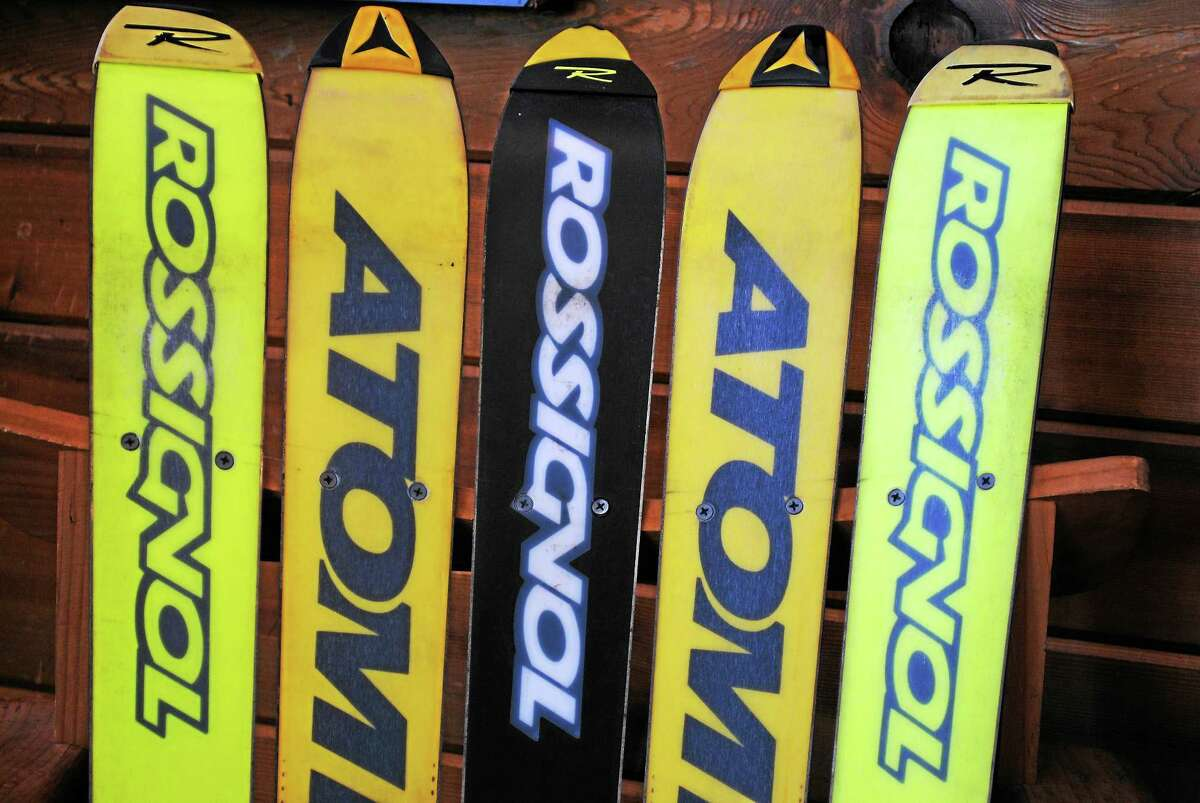 Rossignol and Atomic skis make up the back of a chair at the Ski Haus shop in New Milford.