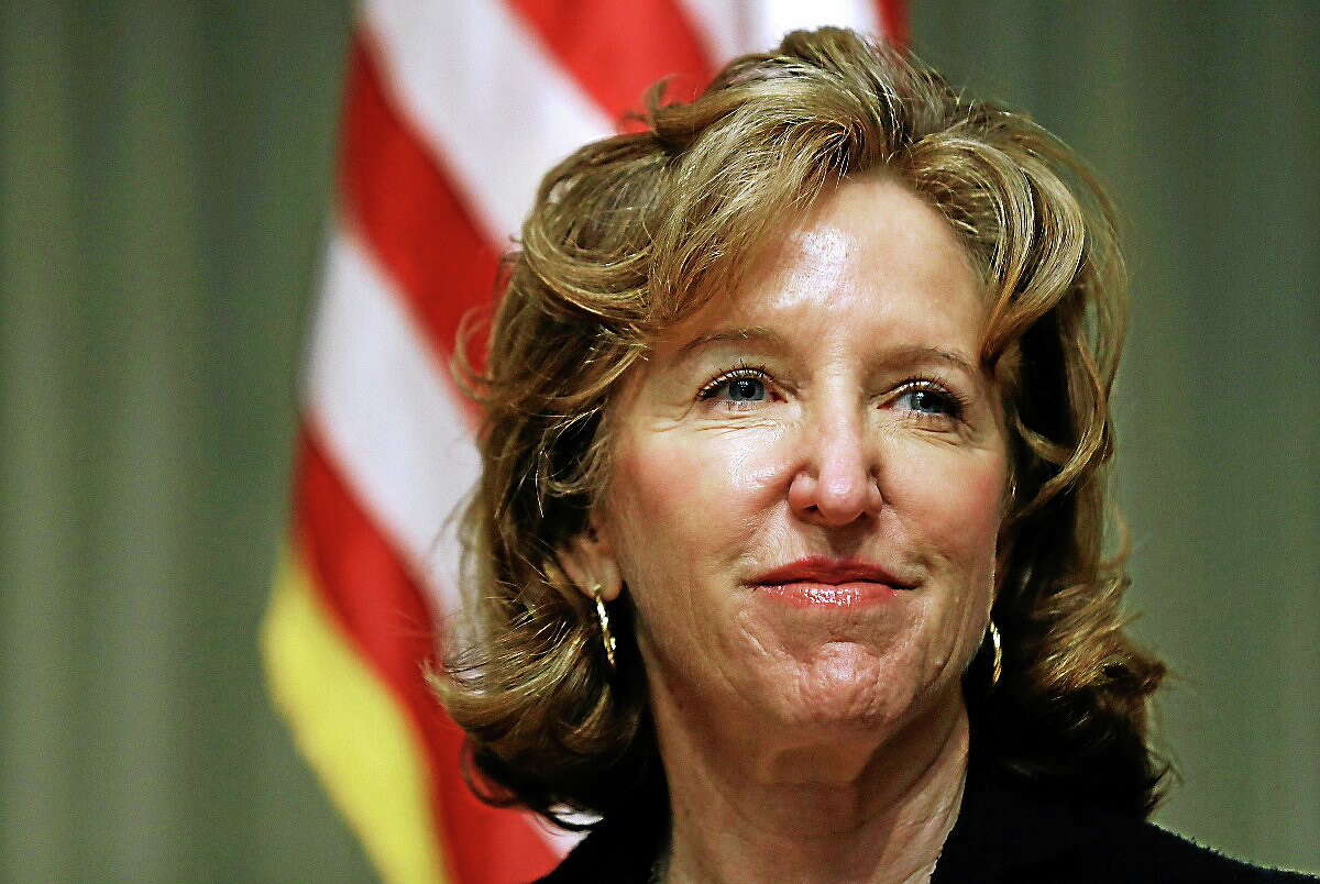 In this April 16, 2014 photo, Sen. Kay Hagan, D-N.C., listens during an appearance in Durham, N.C. Hagan in North Carolina and Jeanne Shaheen in New Hampshire face heavy outside spending but have Emily's List backing.