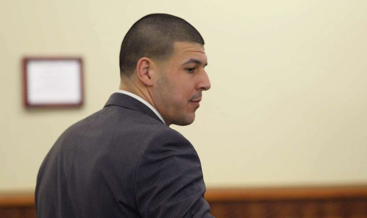 Former New England Patriots football player Aaron Hernandez leaves the courtroom during the jury deliberation in his murder trial at the Bristol County Superior Court in Fall River, Mass. on April 10, 2015. Hernandez is charged with killing Odin Lloyd.