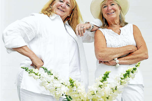 """Branford, Connecticut: August 4, 2017. Noreen Kokoruda, left, and Eileen Banisch, co-chairs of Madison's """"An Evening In White"""" gala."""