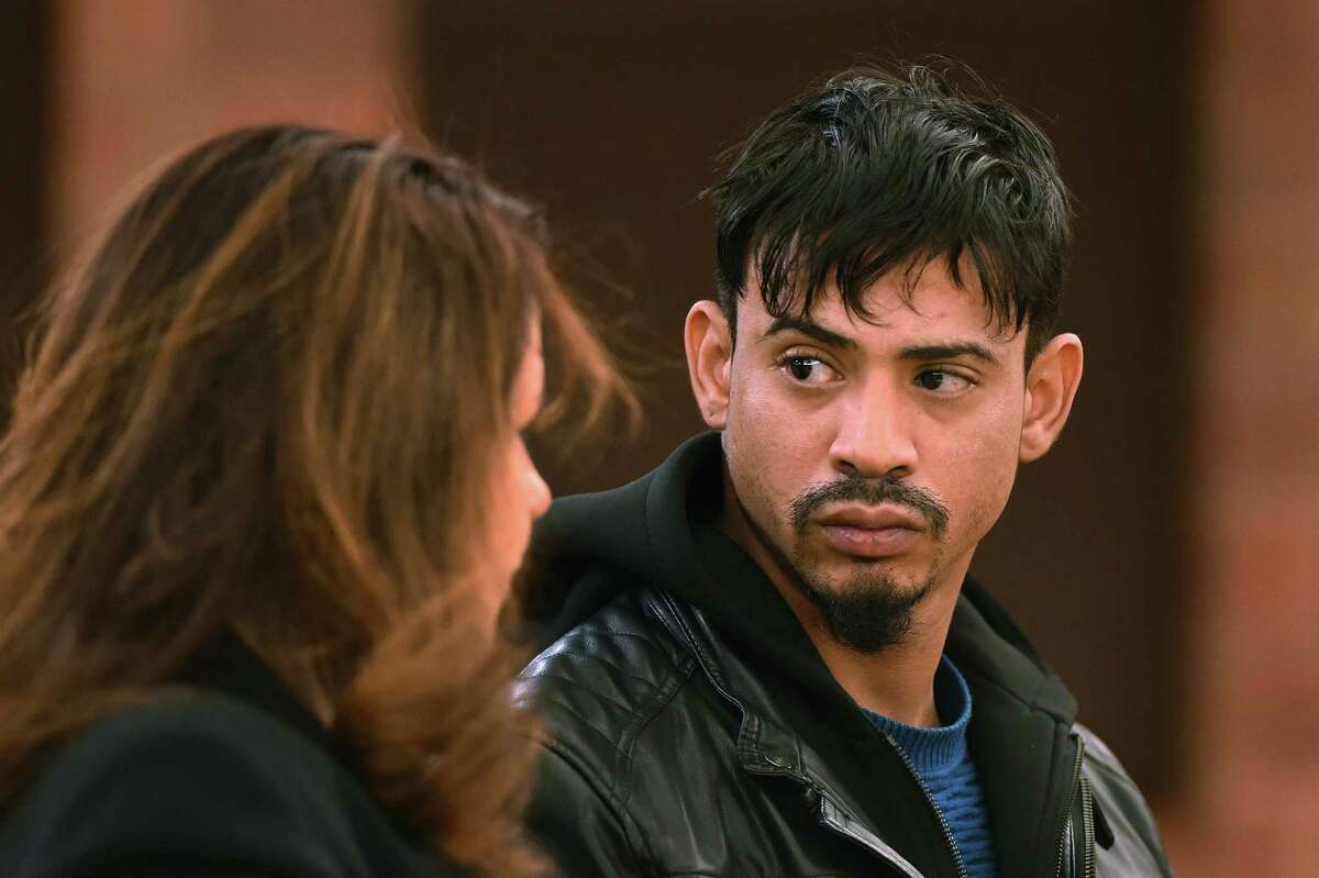 Amador Medina, right, of Hartford, listens to public defender Johanna Canning during his arraignment at Hartford Superior Court Monday, Dec. 7, 2015, in Hartford. Media was charged as a fugitive from justice after police found the remains of five bodies stolen from a Worcester, Massachusetts cemetery in Medina's Hartford apartment on Friday that he claimed were used for religious purposes. He faces five counts of disinterment of bodies, conspiracy and accessory before the fact in Massachusetts, according to police.