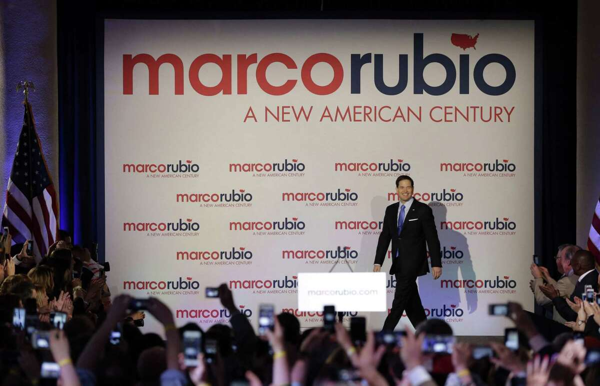 Florida Sen. Marco Rubio smiles as he arrives at a rally at the Freedom Tower, Monday, April 13, 2015, in Miami.