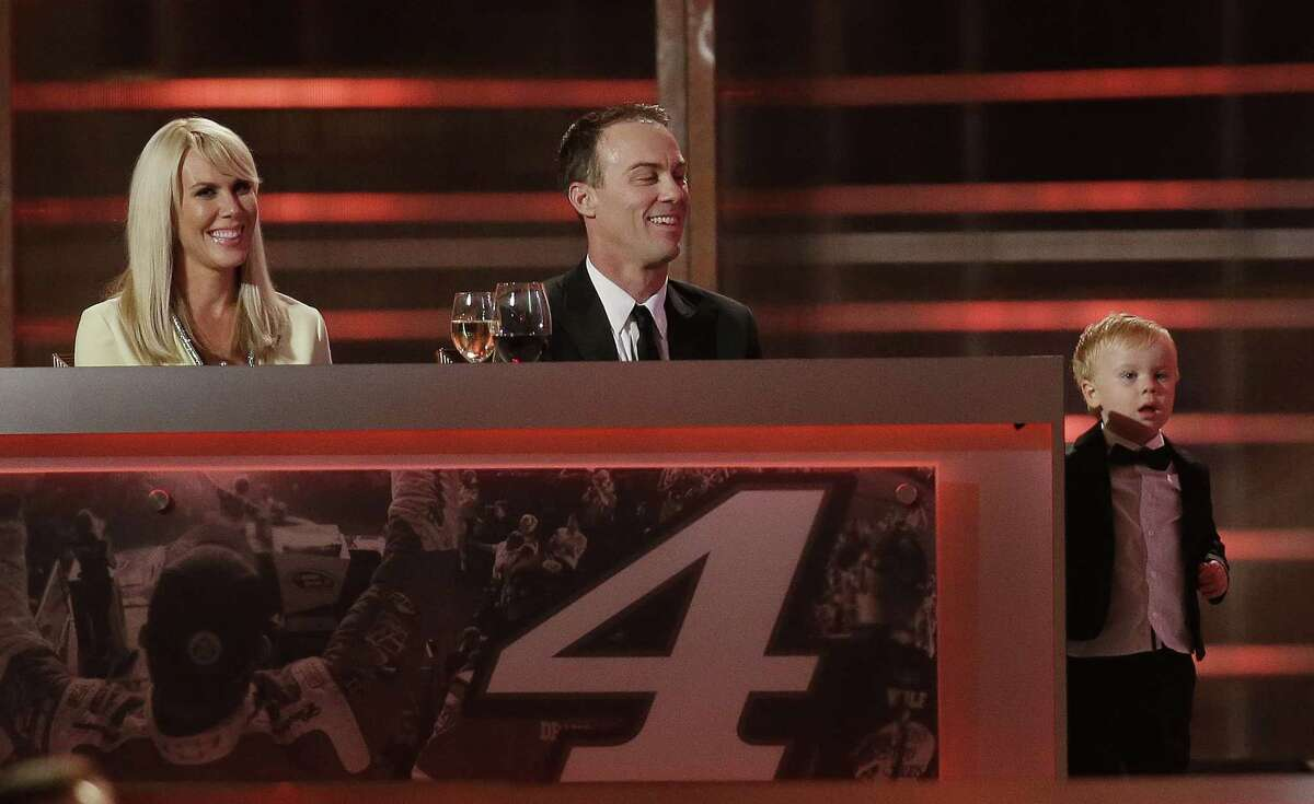 Kevin Harvick, center, and his wife DeLana Harvick, left, watch as their son Keelan reacts to seeing his image on the screen during the NASCAR Sprint Cup Series awards at Wynn Las Vegas last Friday.