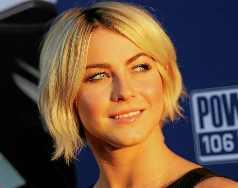 """FILE - In this Thursday, Aug. 7, 2014, file photo, actress Julianne Hough looks back for photographers at the premiere of the film """"Let's Be Cops,"""" in Los Angeles. """"Dancing With the Stars"""" says two-time champion Hough is returning to the ballroom as a judge this season. She will preside alongside Len Goodman, Carrie Ann Inaba and Bruno Tonioli. The new season launches Sept. 15 on ABC. (Photo by Chris PizzelloInvision/AP, File) Photo: Chris Pizzello/Invision/AP / Invision"""