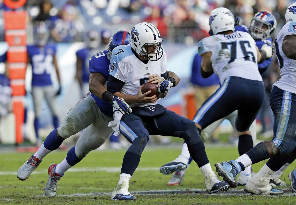 Titans quarterback Zach Mettenberger is sacked by New York Giants linebacker Devon Kennard Sunday in Nashville, Tenn.