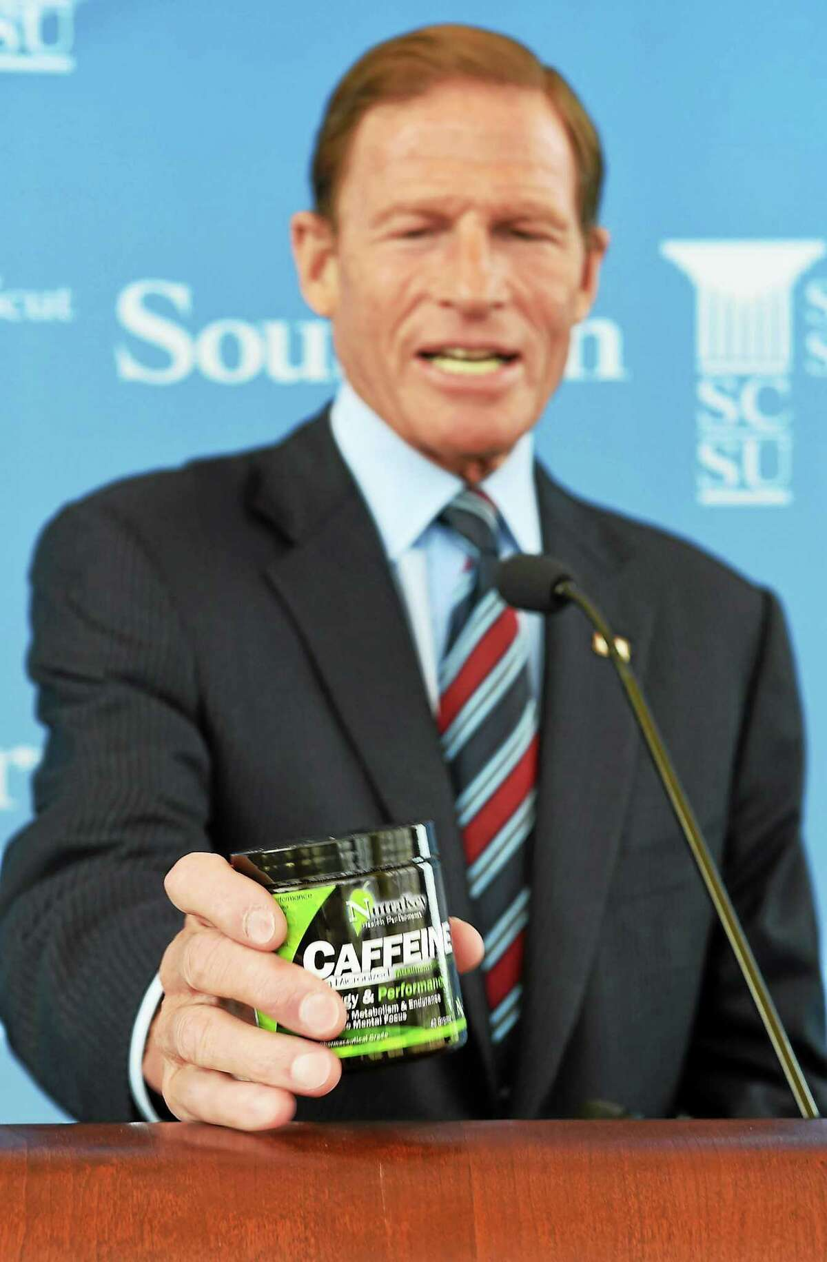 U.S. Senator Richard Blumenthal holds an example of the powdered caffeine he is asking the FDA to remove from store shelves on August 21, 2014.