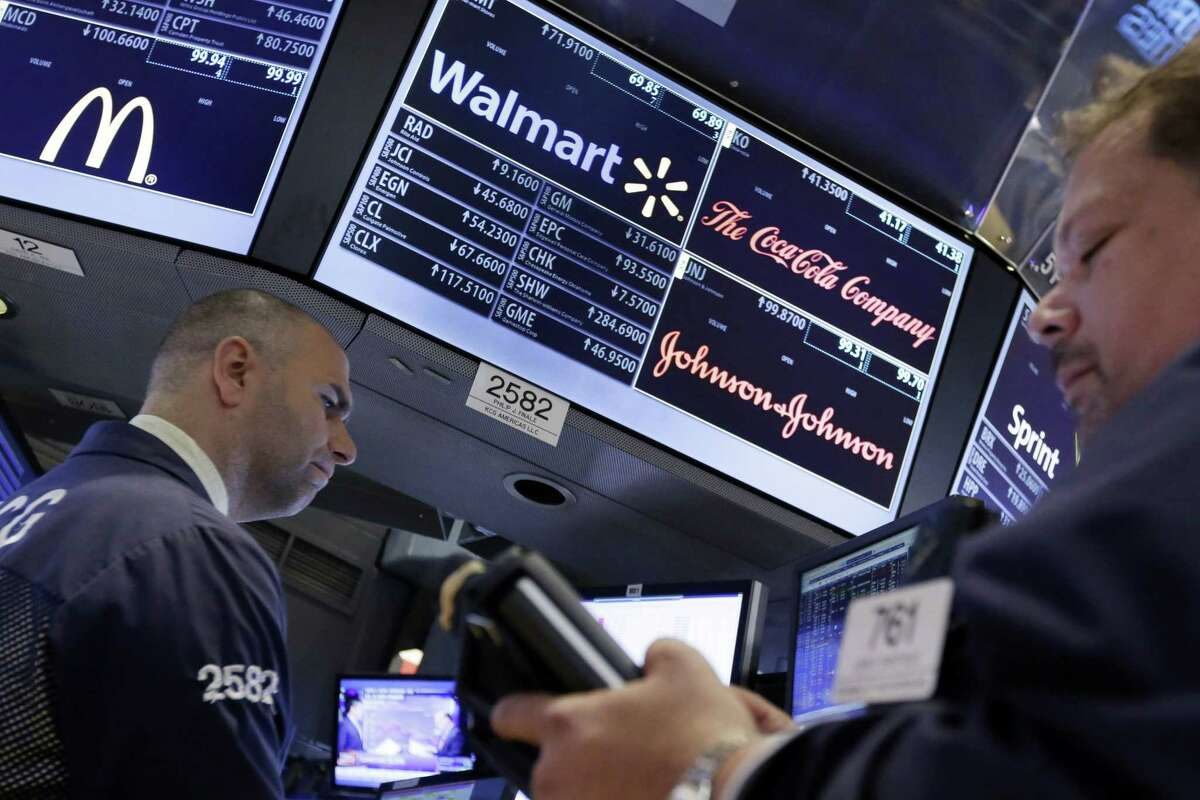 Specialist Philip Finale, left, works at his post that handles Wal-Mart on the floor of the New York Stock Exchange on Aug. 18, 2015. U.S. stocks are lower in early trading after China's main index had its biggest fall since late July.