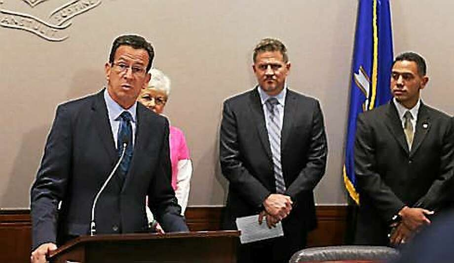 Gov. Dannel P. Malloy with Mohegan Chairman Kevin Brown and Mashantucket Pequot Chairman Rodney Butler Photo: Journal Register Co