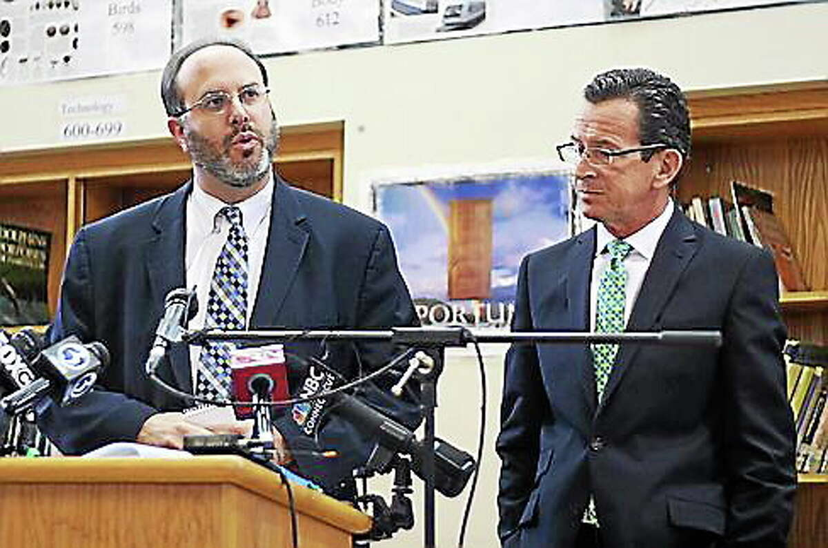 Outgoing state Education Commissioner Stefan Pryor, left, and Gov. Dannel Malloy.