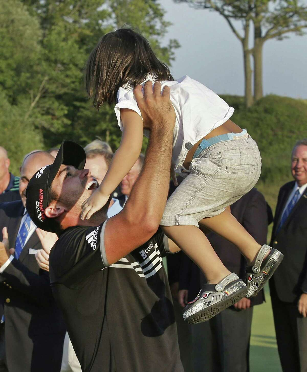 Jason Day holds up his son, Dash, after winning the PGA Championship Sunday at Whistling Straits in Haven, Wis.