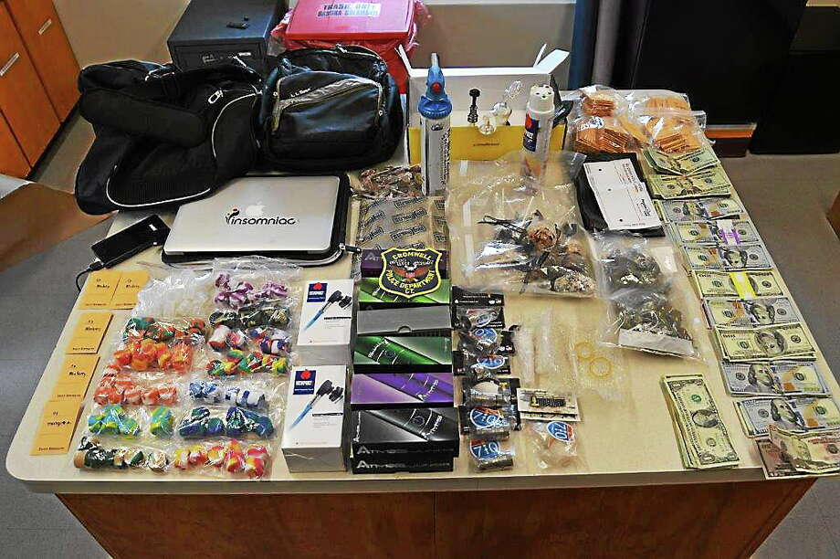 Cromwell police arrested a Shelton woman and East Hartford man on a host of charges Thursday after confiscating $5,000 worth of hash oil, marijuana and pot edibles along with $10,000 in cash in an alleged drug deal in a motel parking lot. Photo: Courtesy Cromwell Police