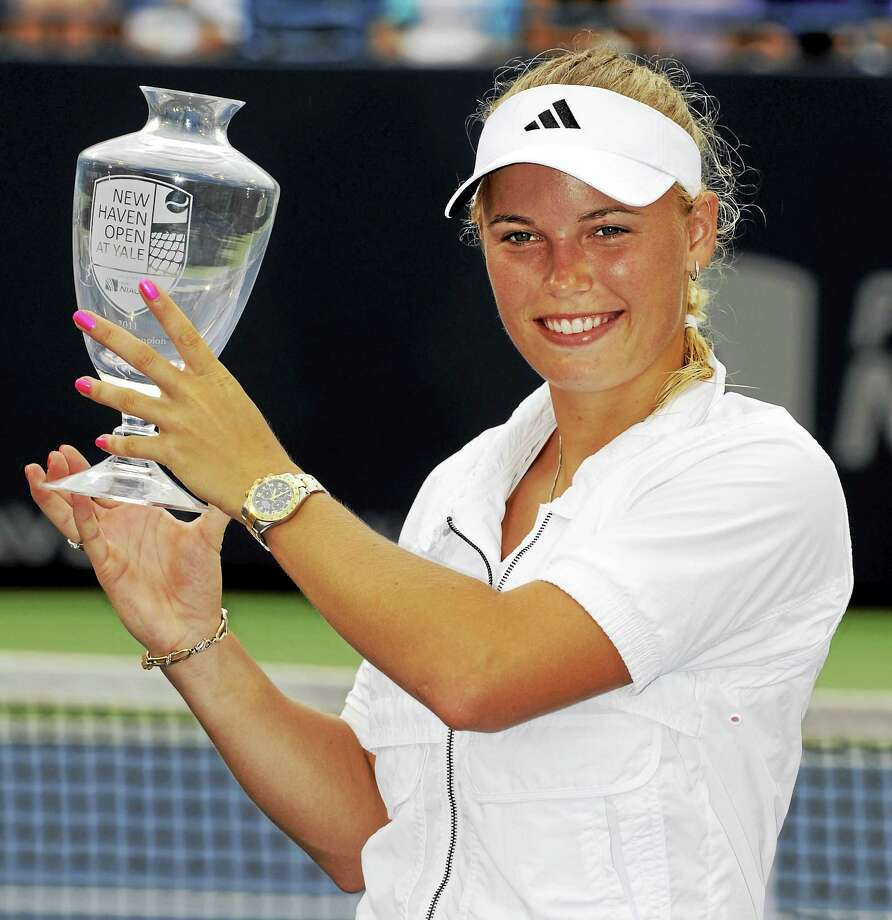 Caroline Wozniacki poses with her trophy after winning the 2011 New Haven Open. Photo: Fred Beckham — The Associated Press File Photo  / AP2011