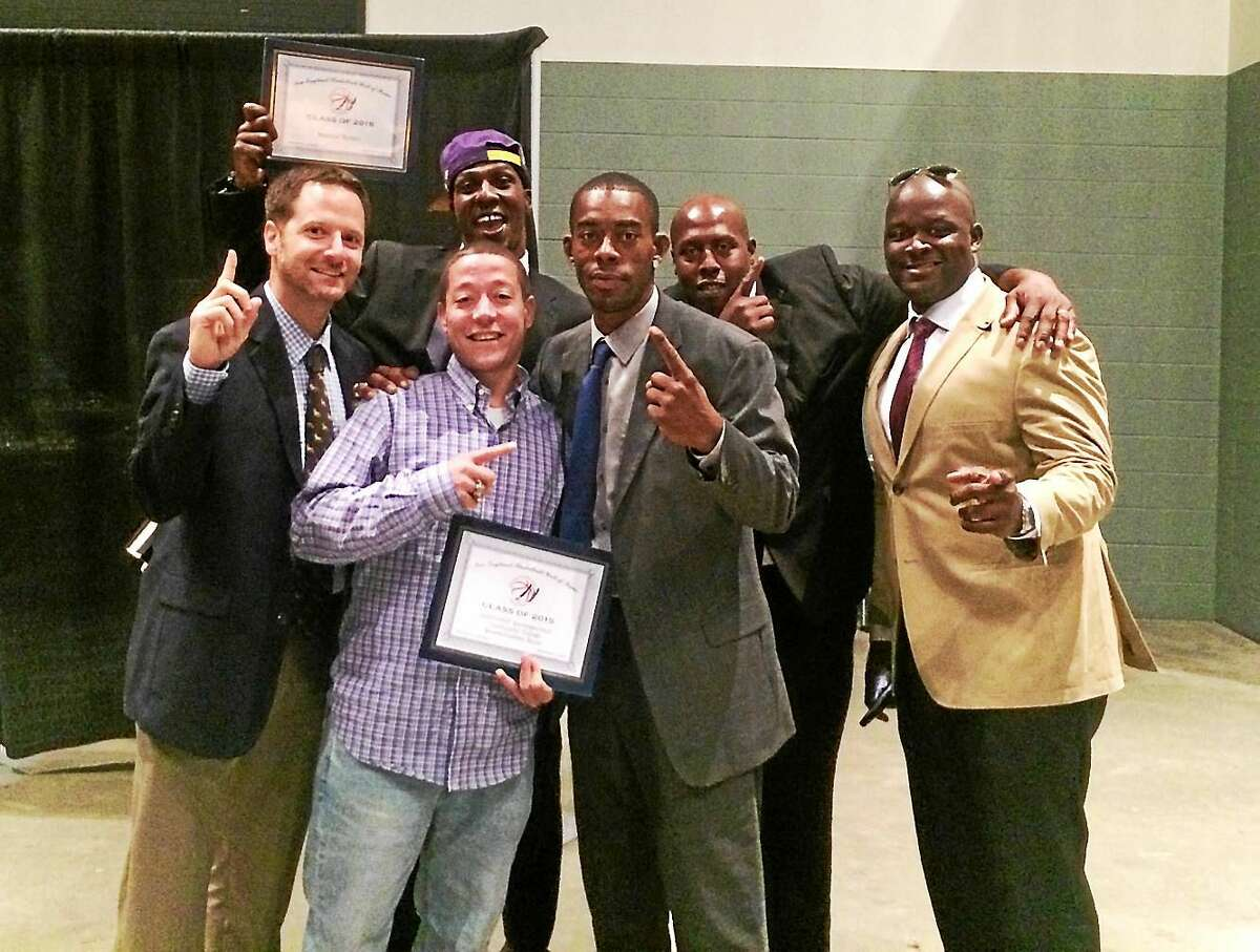 The 2006-2007 Quinisigamond Community College basketball team, coached by Middletown's Jon Winer, was inducted into the New England Basketball Hall of Fame on August 8. Pictured, from left, is Winer with former players Maurice Horton, Al Jenkins, Dennis Williams, Courtney Mills, and Kojo Asenso.