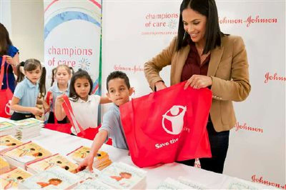 """IMAGE DISTRIBUTED FOR JOHNSON & JOHNSON - Univision's Karla Martinez joins students from Hialeah Elementary School (Fla.) to launch the Johnson & Johnson """"Champions of Care"""" program, on Thursday, March 6, 2014, in Hialeah, Fla. (Photo by Mitchell Zachs/Invision for Johnson & Johnson/AP Images)"""
