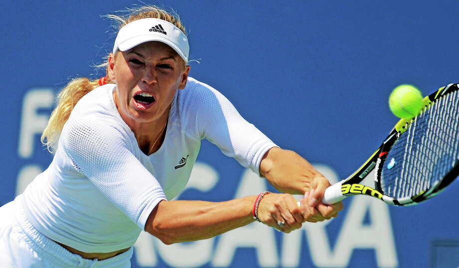 Four-time Connecticut Open champion Caroline Wozniacki lunges for the ball during her second-round loss to Camila Giorgi on Wednesday afternoon at the Connecticut Tennis Center. Photo: Bob Child — For The Register  / New Haven Register
