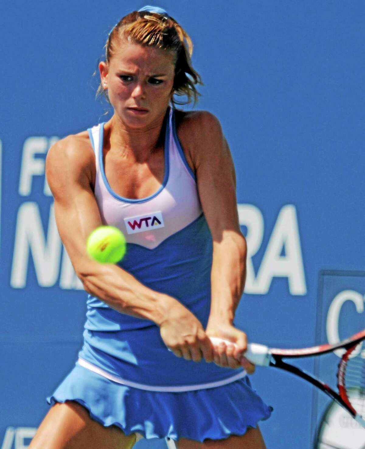 Camila Giorgi gets set to hit a return during her second-round victory over Caroline Wozniacki on Wednesday afternoon at the Connecticut Open.