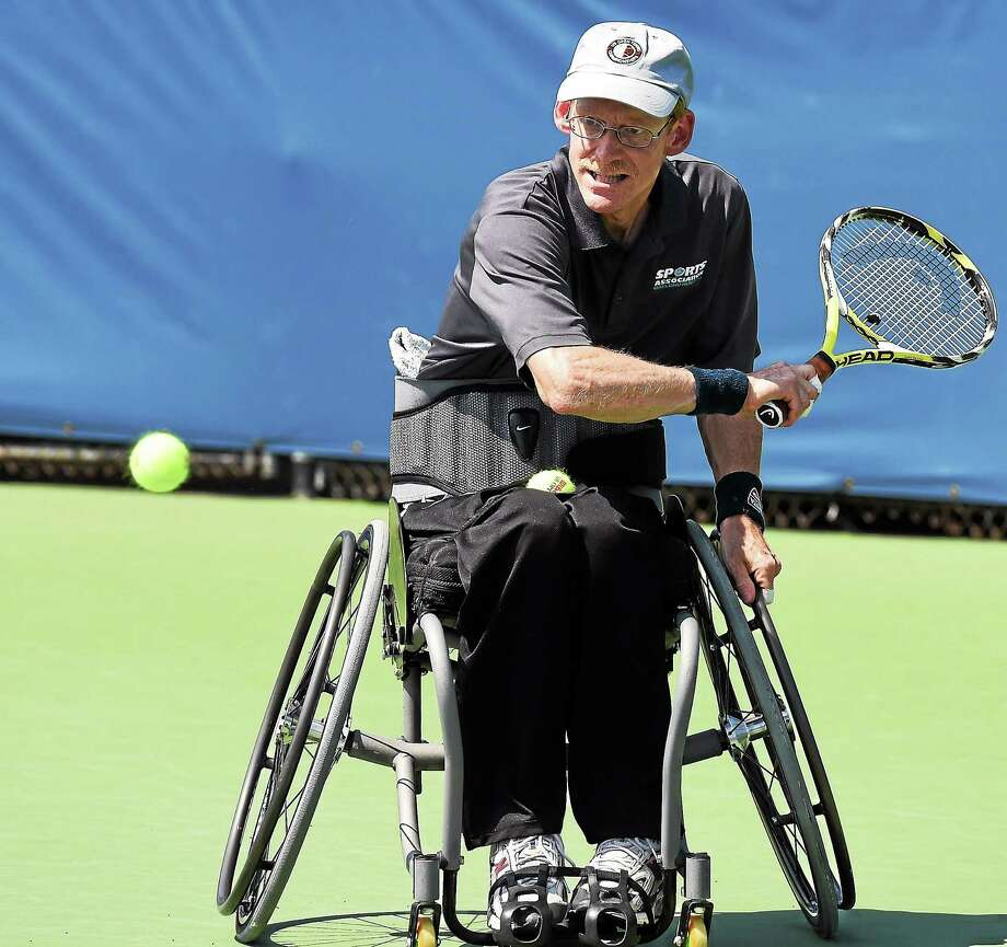 The Gaylord Hospital Adaptive Sports Association brought its wheelchair tennis team to the Connecticut Open on Wednesday afternoon for a demonstration along with athletes from the Magic Lincer Tennis Academy in Windsor. Photo: Mara Lavitt — Register  / Mara Lavitt