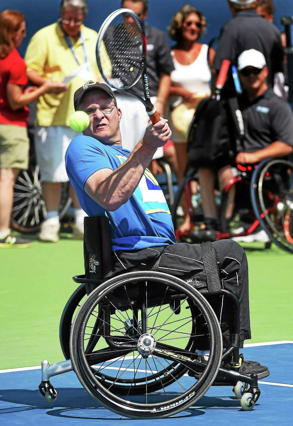 (Mara Lavitt ó New Haven Register) August 20, 2014 New Haven Gaylord Sports Assoc. brought wheelchair tennis team members, as well as athletes from the Magic Lincer Tennis Academy in Windsor to conduct an adaptive tennis demonstration at the Connecticut Open. Ryan Martin of Monroe returns. mlavitt@newhavenregister.com