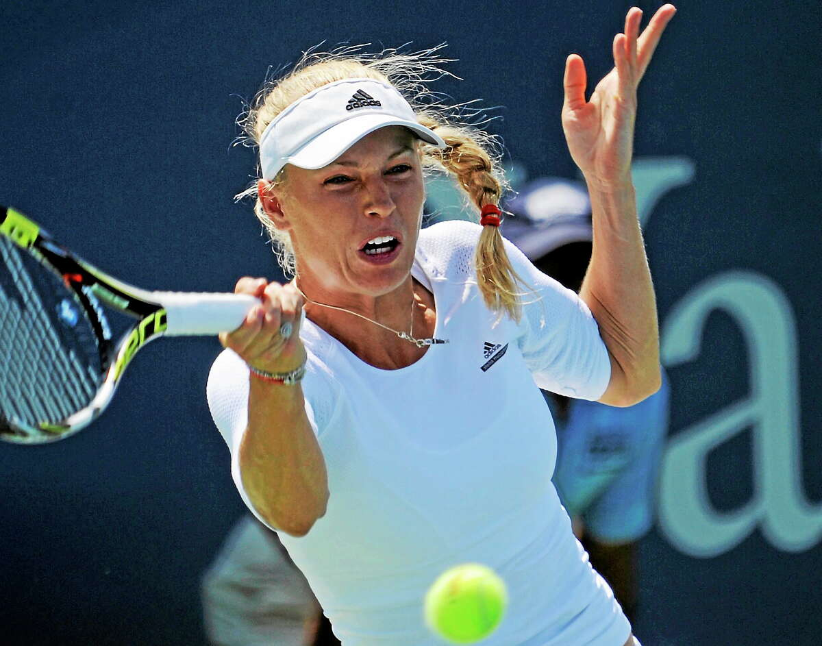 Denmark's Caroline Wozniacki hits a return at the Connecticut Open in New Haven Wednesday, Aug. 20, 2014. P_hoto by Bob Child
