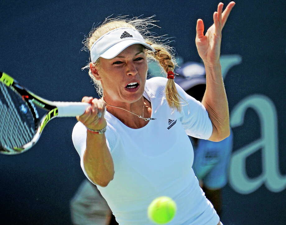 Denmark's Caroline Wozniacki hits a return at the Connecticut Open in New Haven Wednesday, Aug. 20, 2014.  P_hoto by Bob Child Photo: New Haven Register / New Haven Register
