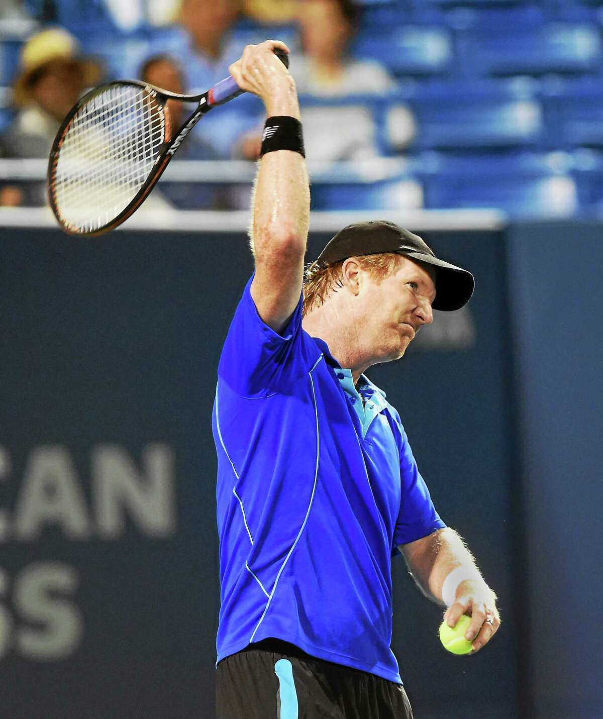 Jim Courier pretends to be angry as he challenges a call by a line judge during his exhibition match with James Blake on Wednesday night at the Connecticut Tennis Center.