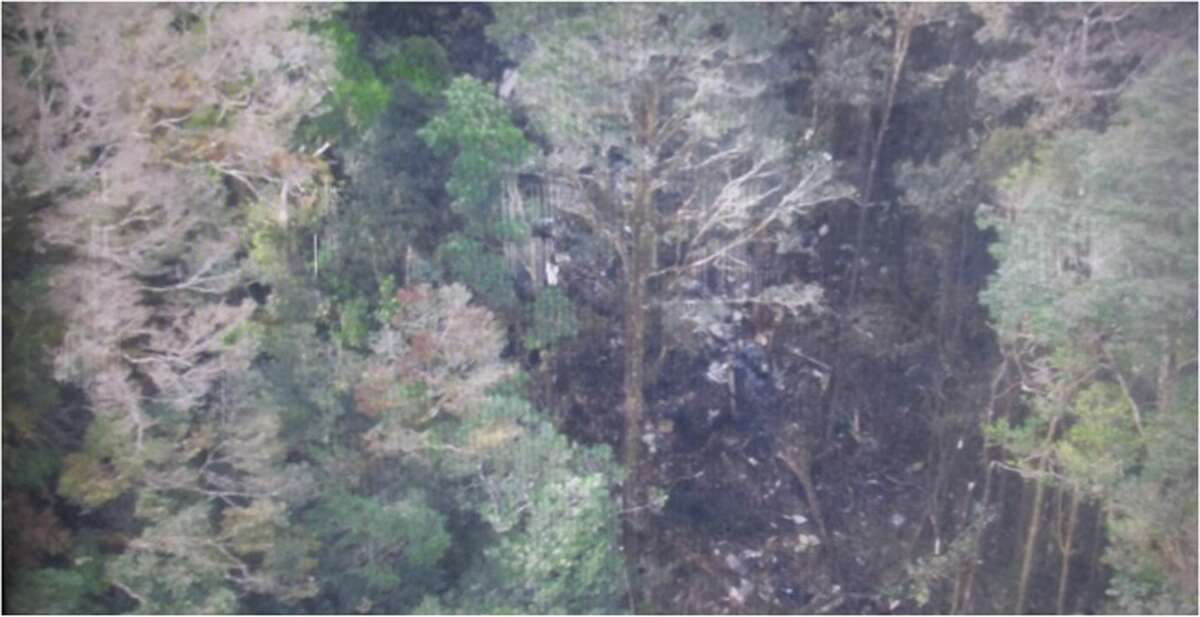 This photo released by the National Search and Rescue Agency (BASARNAS) of Indonesia on Aug. 17,2015 shows the part of the wreckage that BASARNAS identified as of the missing Trigana Air Service flight that crashed in Oksibil, Papua, Indonesia.