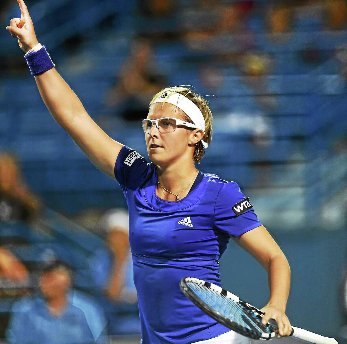 Kirstin Flipkens reacts to winning her maraton match against Andrea Petkovic at the Connecticut Open on Wednesday.
