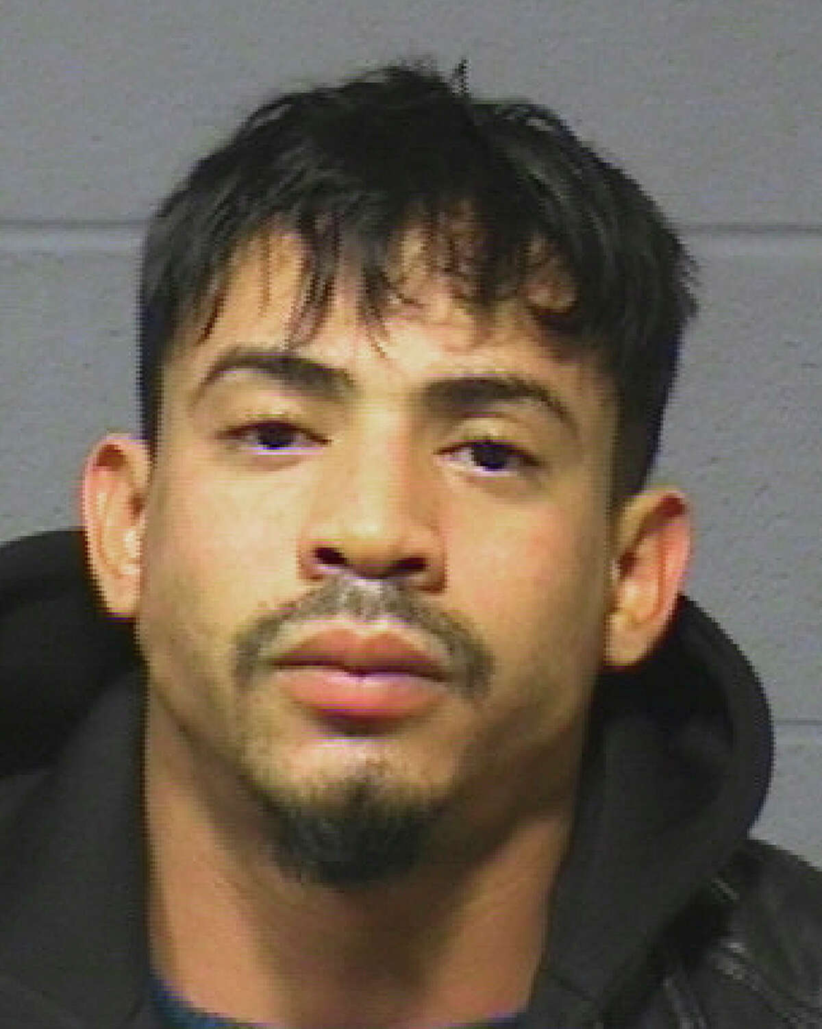 Hartford Police Department via AP This booking photograph released Dec. 7, 2015 by the Hartford, Conn., Police Department shows Amador Medina, arrested Friday on fugitive from justice charges. He is suspected of stealing skeletal remains from a Worcester, Mass. cemetery.