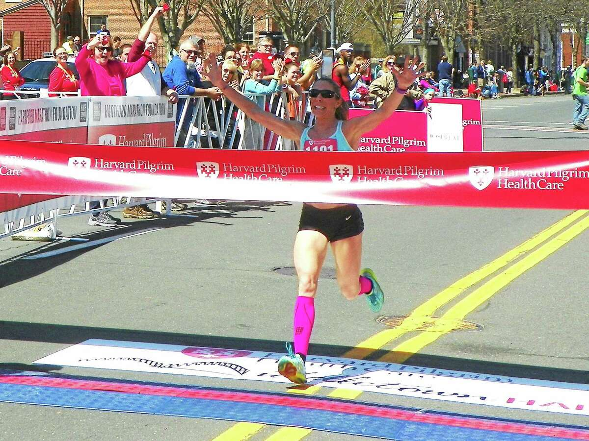 Sybil Shapiro of Clinton wins her second straight Middletown Half Marathon with a course record time.