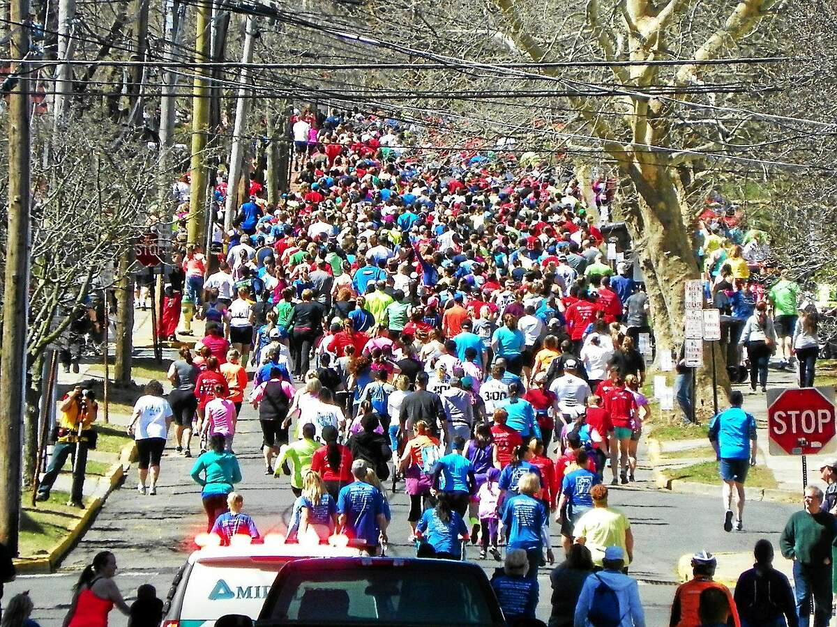 The runners make their way up Court Street at the start of the Middletown Half Marathon and Legends Four Mile run on Sunday.