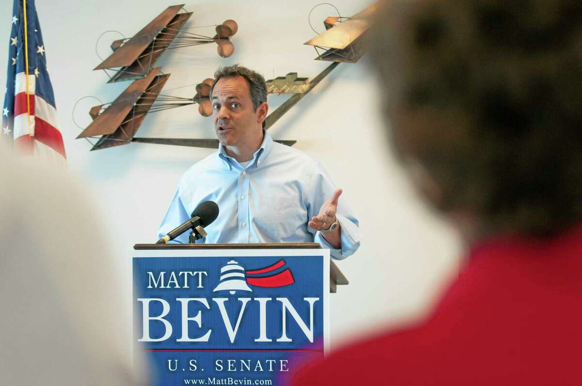 Then U.S. Senate candidate Matt Bevin speaks to supporters in this 2014 photograph at a fly-in at the Bowling Green-Warren County Regional Airport in Bowling Green, Kentucky.