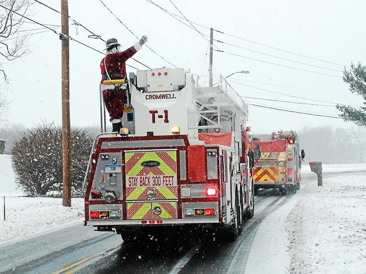 In this file photo, snow didn't stop Cromwell firefighters from making the annual Santa's Run.