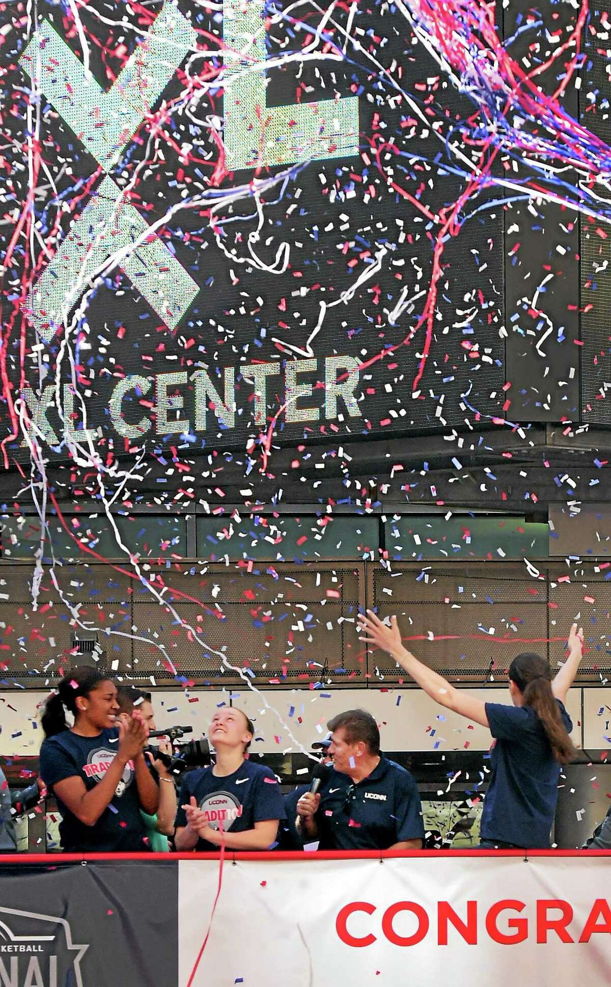 (Peter Hvizdak - New Haven Register) Confetti falls on the 2015 NCAA National Champion University of Connecticut Women's Basketball team as it is honored during a rally after a victory parade sponsored by the State of Connecticut, the City of Hartford, and the Hartford Business Improvement District Sunday afternoon congratulating them for their efforts.