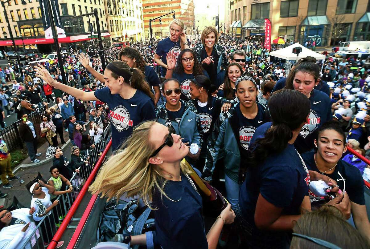 (Peter Hvizdak - New Haven Register) The 2015 NCAA National Champion University of Connecticut Women's Basketball team is cheered as a bus brings them up Trumbull Street during a victory parade and rally sponsored by the State of Connecticut, the City of Hartford, and the Hartford Business Improvement District Sunday afternoon congratulating them for their third straight championship.