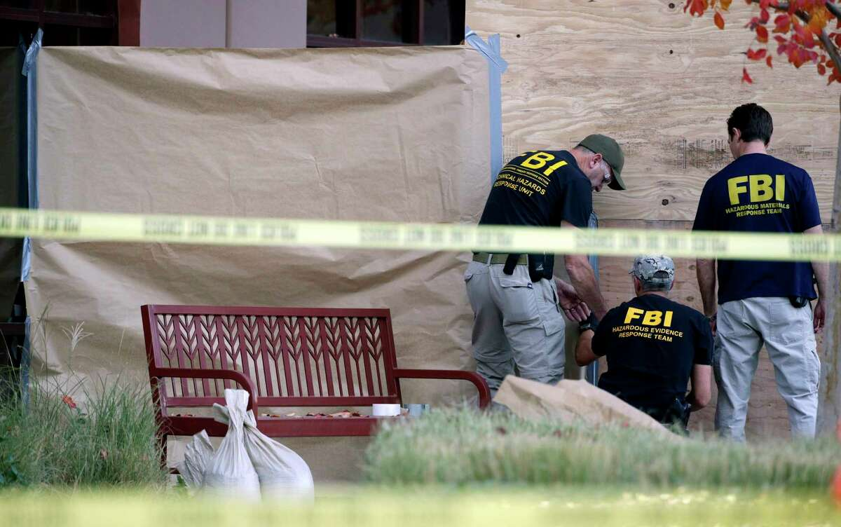 JAE C. HONG — ASSOCIATED PRESS PHOTO Investigators work Monday at the site of a Dec. 2 mass shooting at the Inland Regional Center in San Bernardino, Calif.