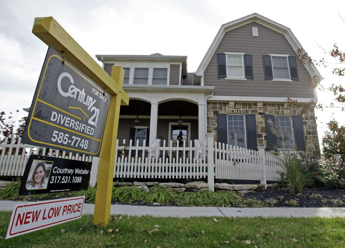 This Oct. 20, 2009 photo, shows a home with a reduced price for sale in Carmel, Ind., neighborhood. Short of cash and unsettled in their careers, young Americans are waiting longer than ever to buy their first homes. The delay reflects a trend that cuts to the heart of the financial challenges facing millennials: Renters are struggling to save for down payments.