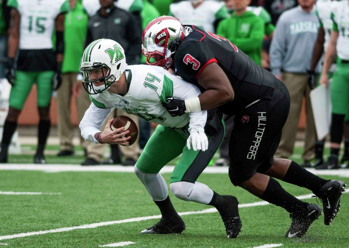 Quarterback Chase Litton (14) and Marshall will be UConn's opponent in the St. Petersburg Bowl.
