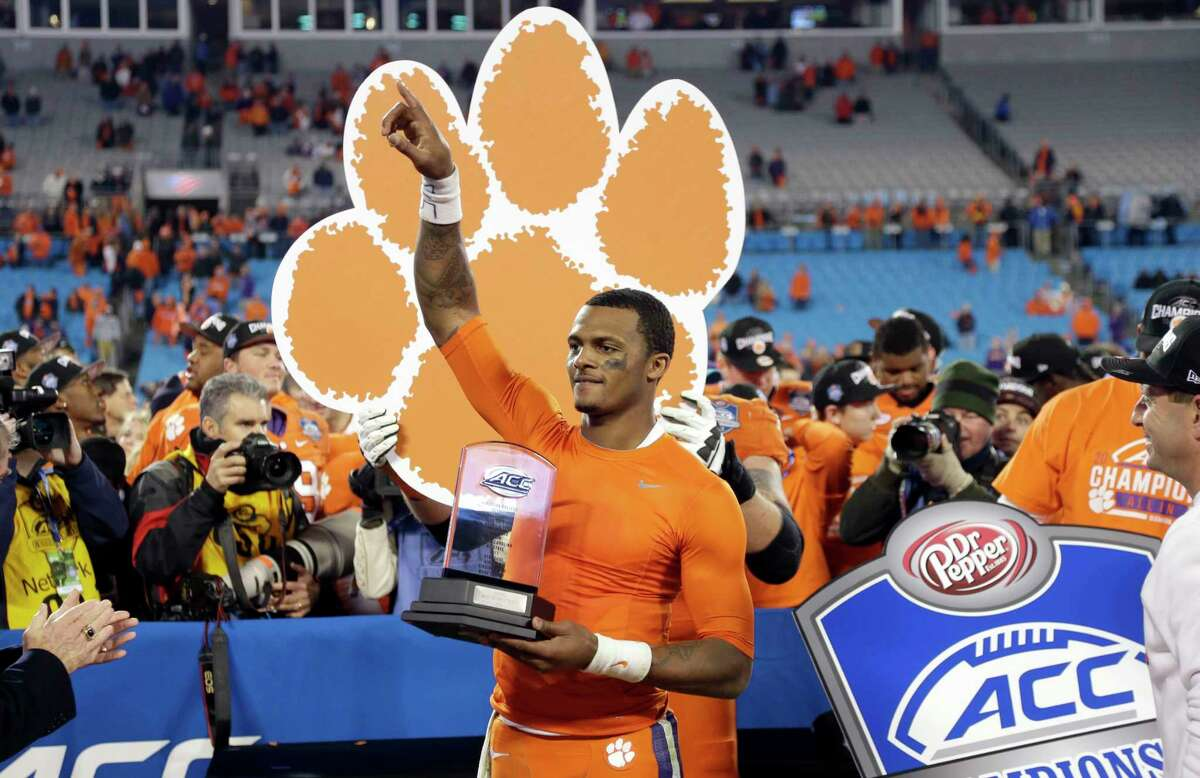 Clemson quarterback Deshaun Watson holds the most valuable player trophy after the Tigers defeated North Carolina in the ACC championship game on Saturday.