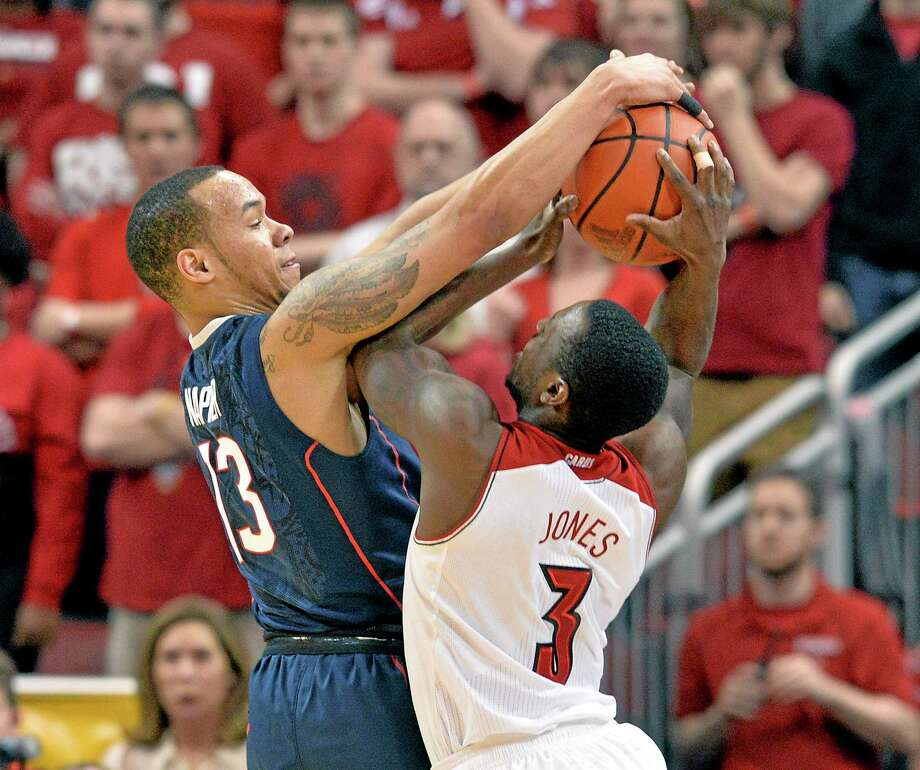 UConn's Shabazz Napier, here blocking the shot of Louisville's Chris Jones on Saturday, was a unanimous first-team All-AAC pick. The player of the year will be announced on Wednesday. Photo: Timothy D. Easley — The Associated Press  / FR43398 AP