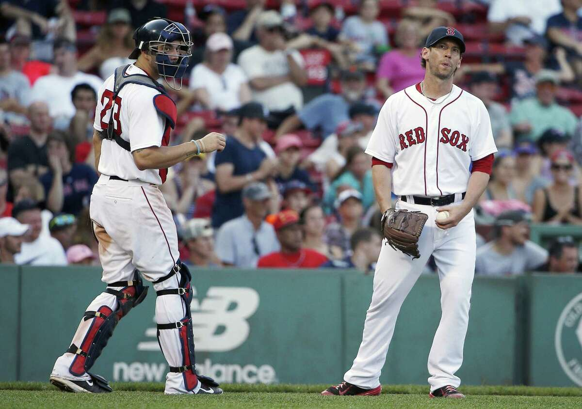 Craig Breslow, right, reacts during the 12th inning of Sunday's game against the Mariners.
