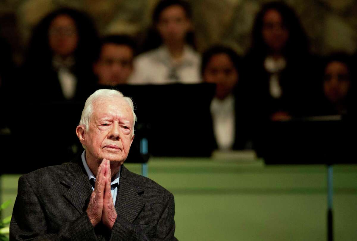In an Aug. 23, 2015 photo, former President Jimmy Carter teaches Sunday School class at Maranatha Baptist Church in his hometown, in Plains, Ga.