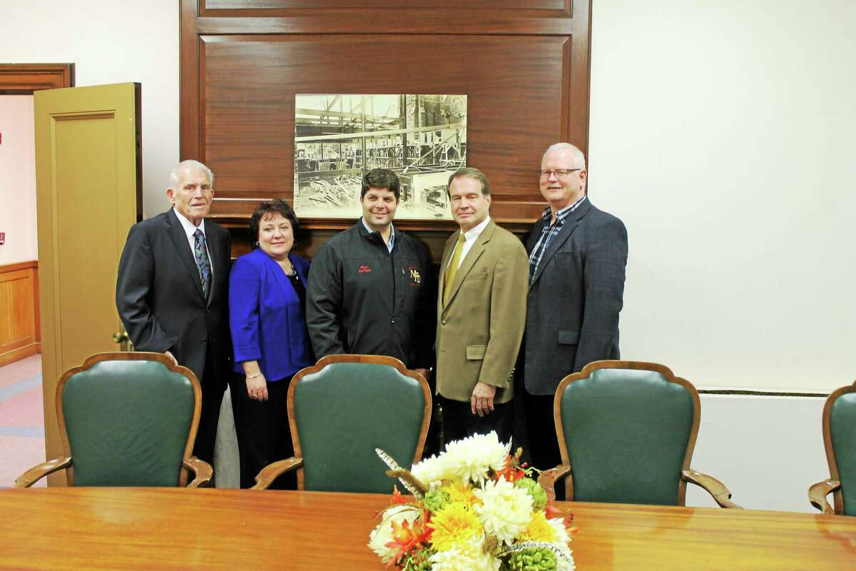 A 100th birthday party for The Central, the classic building at 363 Main St., was held on Nov. 12. From left are: Chamber President Larry McHugh, Downtown Business District Chairwoman Diane Gervais of Amato's Toy and Hobby, Mayor Dan Drew, Trevor Davis, and chamber Central Business Bureau Chairman Tom Byrne.