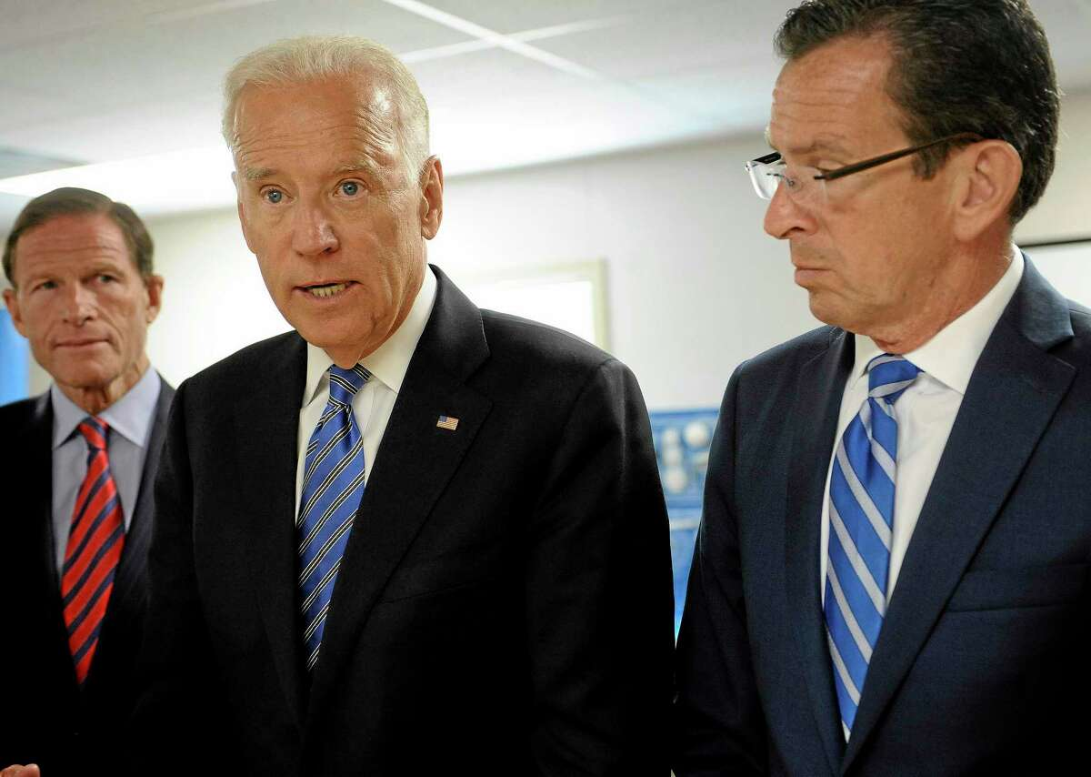 Vice President Joe Biden, center, accompanied by Sen. Richard Blumenthal, D-Conn., left, and Connecticut Gov. Dannel P. Malloy, speaks at Goodwin College, Wednesday, Aug. 20, 2014, in East Hartford, Conn. Biden said manufacturing jobs are coming back to the US, but workers need the right training to fill those positions. Biden credited efforts in Connecticut, including Goodwin College in East Hartford, to match job training with the needs of large and small manufacturers. He called it a model for the rest of the nation. (AP Photo/Jessica Hill)
