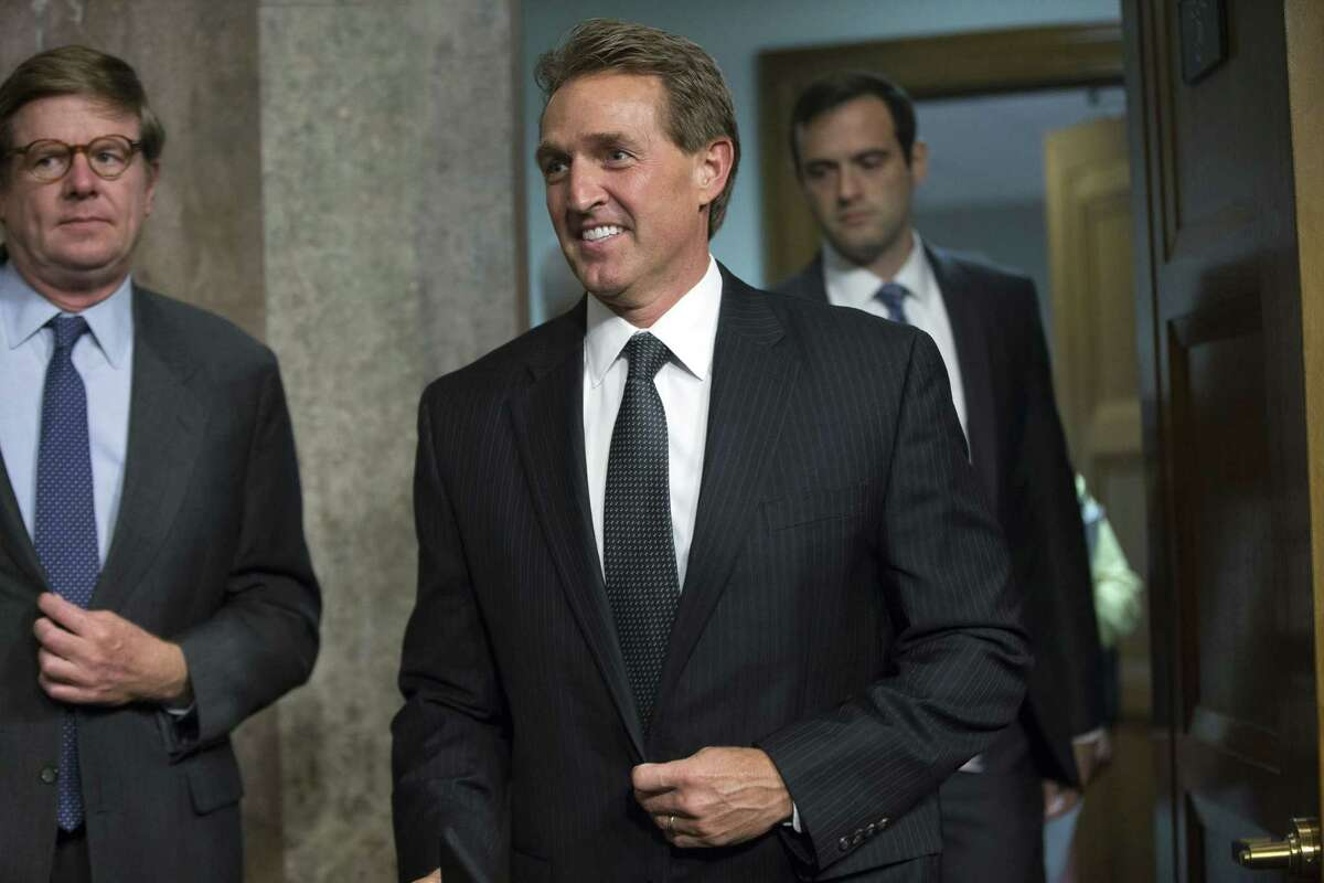 In this July 23, 2015 photo, Sen. Jeff Flake, R-Ariz., arrives before Secretary of State John Kerry, Secretary of Energy Ernest Moniz, and Secretary of Treasury Jack Lew, arrive to testify at a Senate Foreign Relations Committee hearing on Capitol Hill, in Washington.