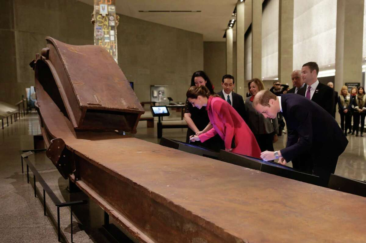 Kate, Duchess of Cambridge, and Britain's Prince William, do a virtual signing of the South Tower Column, during their visit to the National September 11 Museum, Tuesday, Dec. 9, 2014. (AP Photo/Richard Drew, Pool)