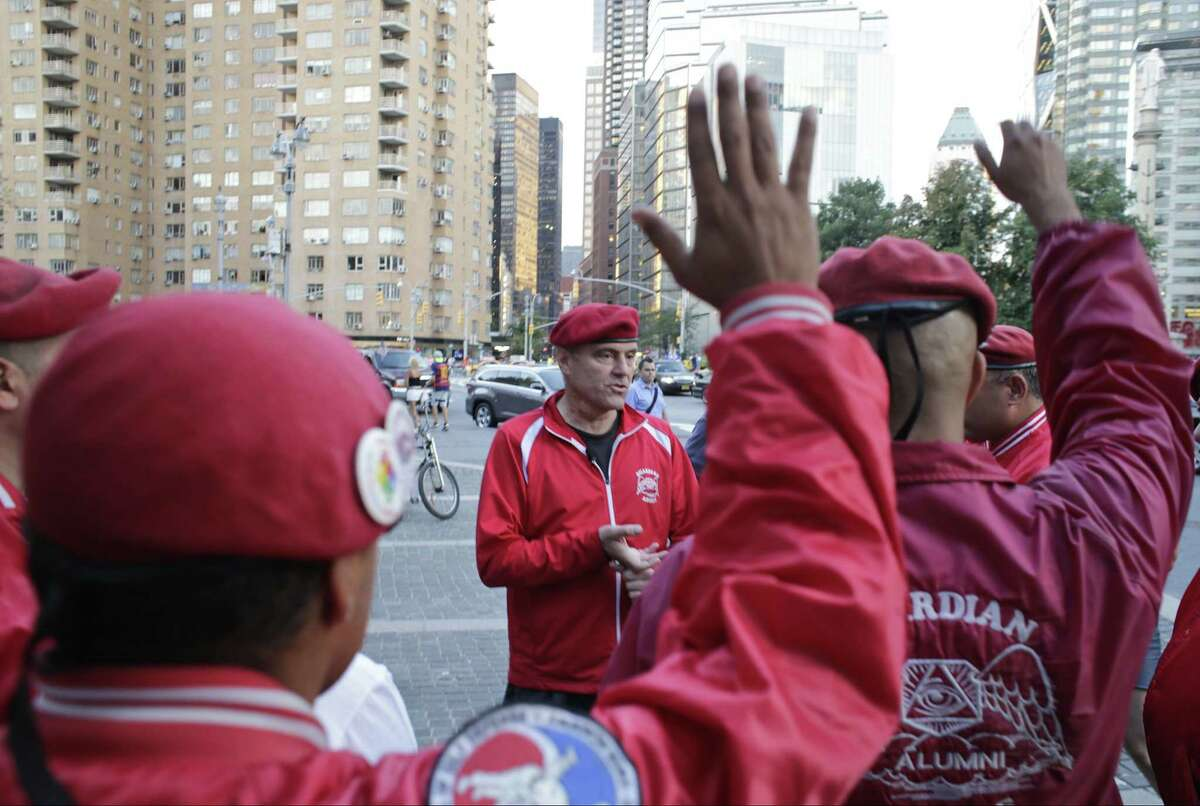 Curtis Sliwa speaks to members of the Guardian Angels before leading them through Central Park on Aug. 12, 2015, in New York. Guardian Angels volunteers made a return this month to Central Park for the first time in over two decades, citing a 26 percent rise in crime there so far this year.